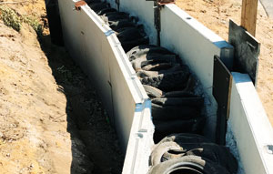 Tyre Stewardship Australia-accredited recycler Lomwest Enterprises is exploring new applications and opportunities for its wall system incorporating end-of-life tyres.